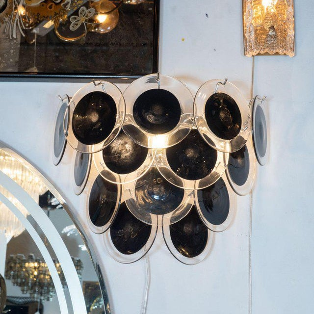 This beautiful pair of modernist 14-disc vistosi sconces were made exclusively for High Style Deco by our atelier in...