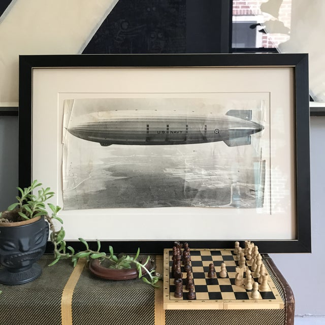 """Carefully restored and preserved under museum glass. This historic 9.5""""x18"""" photo of the USS Akron Airship floats on its..."""