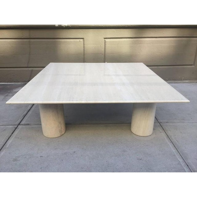 Mario Bellini Large Italian marble coffee table with cylindrical legs.