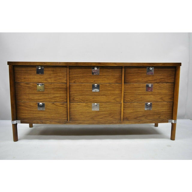 Vintage Mid Century Modern Walnut & Chrome 9 Drawer Credenza Dresser with Mirror. Item features chrome trim and hardware,...
