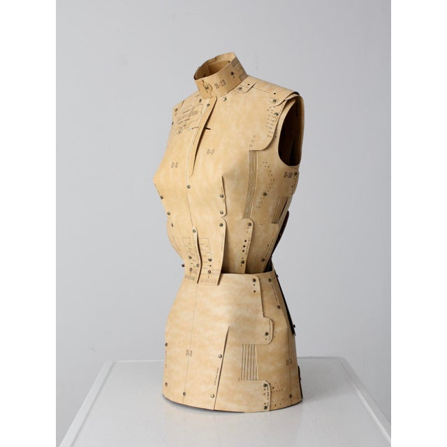 This is a vintage Adjust-O-Matic dress form circa 1960. The adjustable form is made entirely of card stock and fasteners....