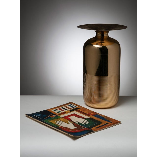 Large vase made out of a thin brass sheet.