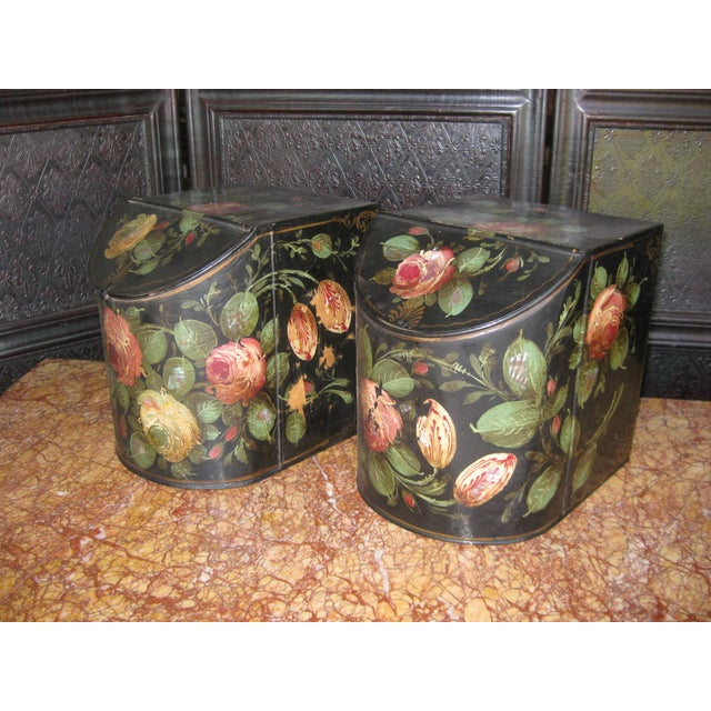 Offered is a beautiful pair of antique English tole storage containers with floral painted and mother of pearl surfaces.
