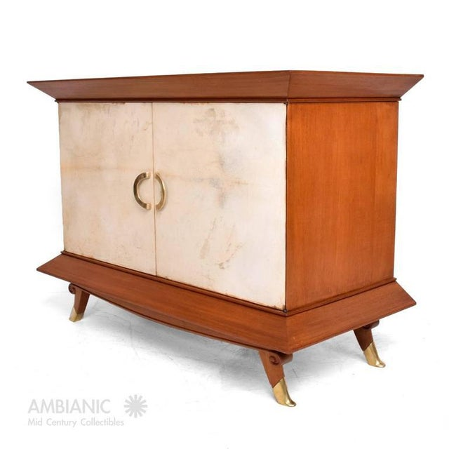 For your consideration a Mexican modernist cabinet attributed to Arturo Pani, Mexico, circa 1950s. Mahogany wood with...