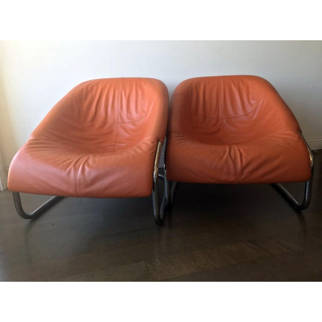fancy leather lounge chairs, orange colored. Perfect to sit in and enjoy reading a book or lounge along in good company...