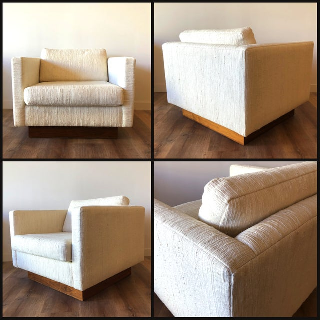 Boucle upholstered fabric and walnut base. Mid-century modern design by Scandiline of Norway