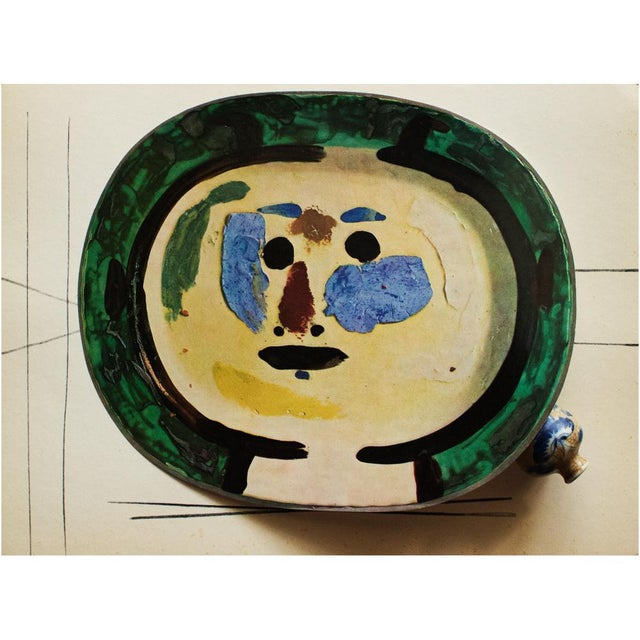 A rare exquisite original period offset lithograph of ceramic plate charger by Pablo Picasso, depicting living face. Comes...