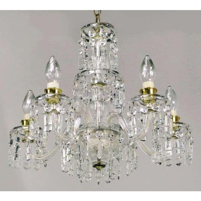 A wonderful early example of the craftsmanship of the American lighting pioneer, Lightolier. Five glass arms meet at the...