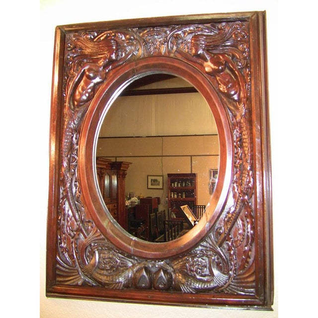 GORGEOUS late 19th Century American highly carved, dark walnut wall mirror. The carving on this mirror is simply stunning....