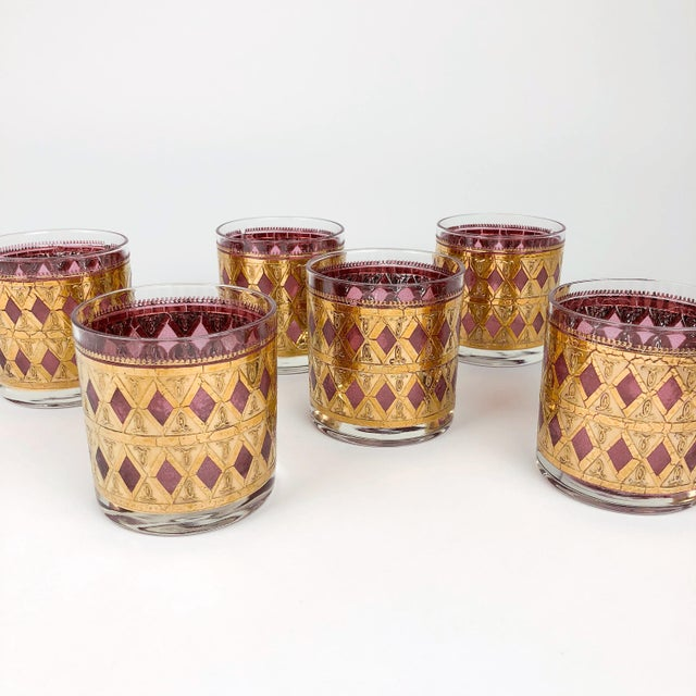 Glam set of mid century pink/purple and gold low ball cocktail glasses.