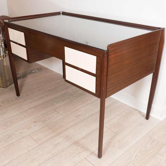 Four drawer wood desk with ivory lacquered drawers and angular legs in the style of Gio Ponti.