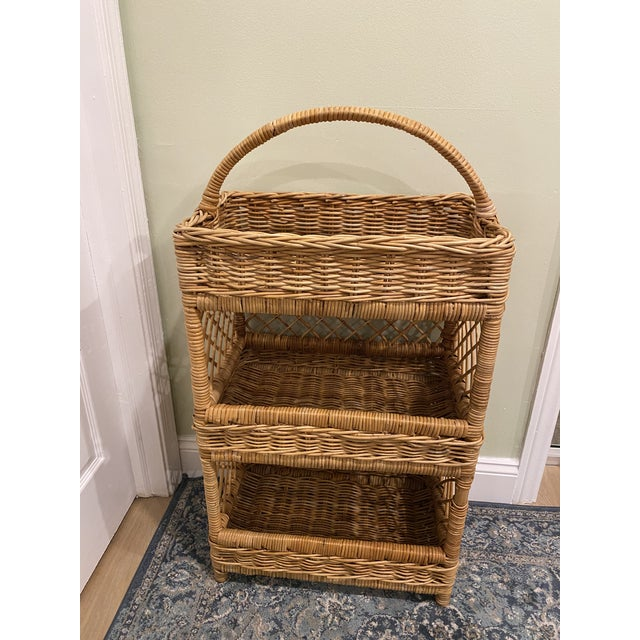 Gorgeous tall natural wicker color palm beach style three tier shelving basket. The shelves are 4 inch deep, and beautiful...