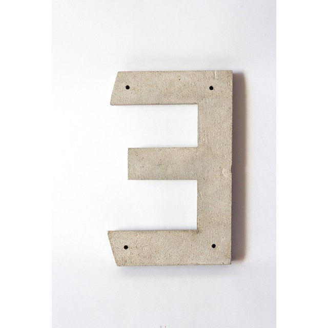 Beautifully aged metal letter E in silver.