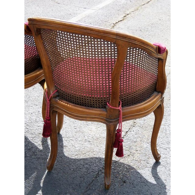 Carved walnut frames. Caned back and seat. Red velvet cushion. Light wear.