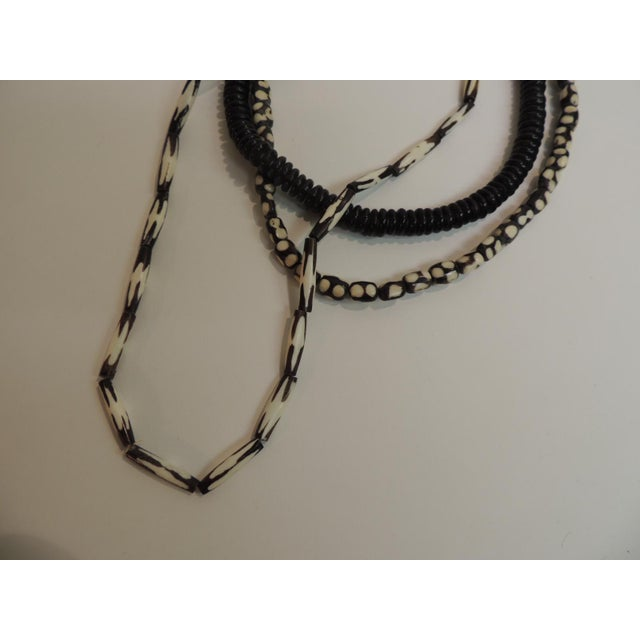 Set of three vintage African beads necklaces with traditional tribal designs. Sizes: from 12 - 16 inches