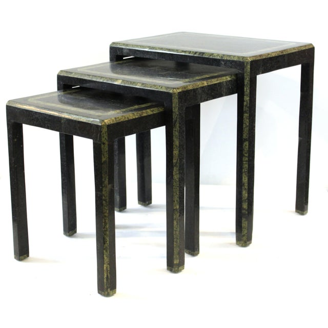 Set of modern nesting tables designed by Maitland-Smith with tessellated polished stone surfaces. Made in the mid-late...