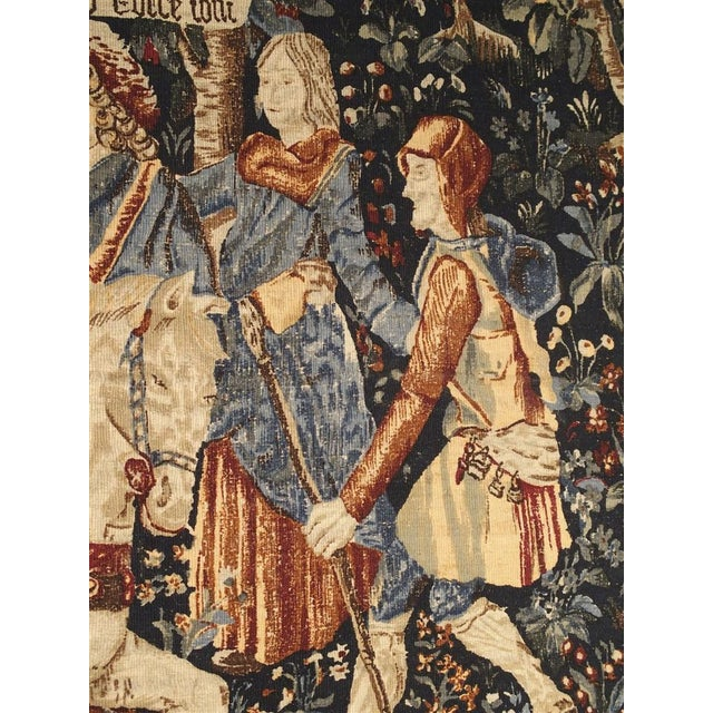 This colorful tapestry is a high quality reproduction of a Medieval style tapestry that would have been woven in the...