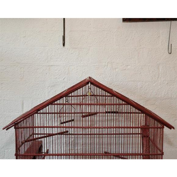 A nice size, bright and decorative bird cage. France, circa 1930's Materials and Techniques: Wood, Brass, Paint....