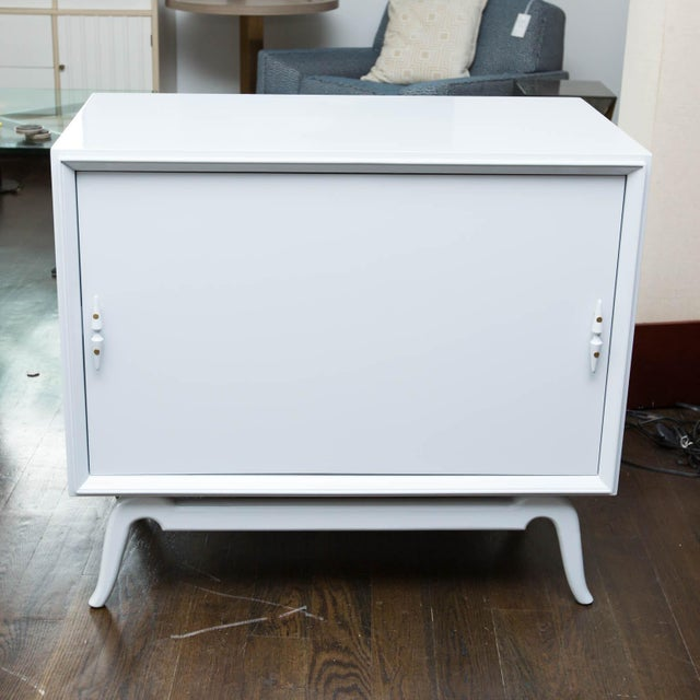 Vintage bar storage that could only come form the 1950s. Just refinished in bunny grey lacquer, this cabinet has a...