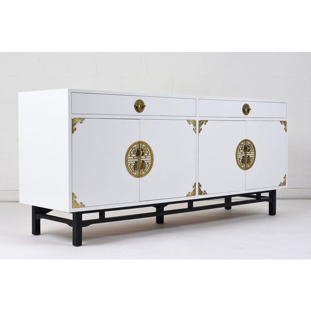 This 1960's Chinese Modern-style credenza is made of maple wood finished in two tones. The credenza is finished in a...
