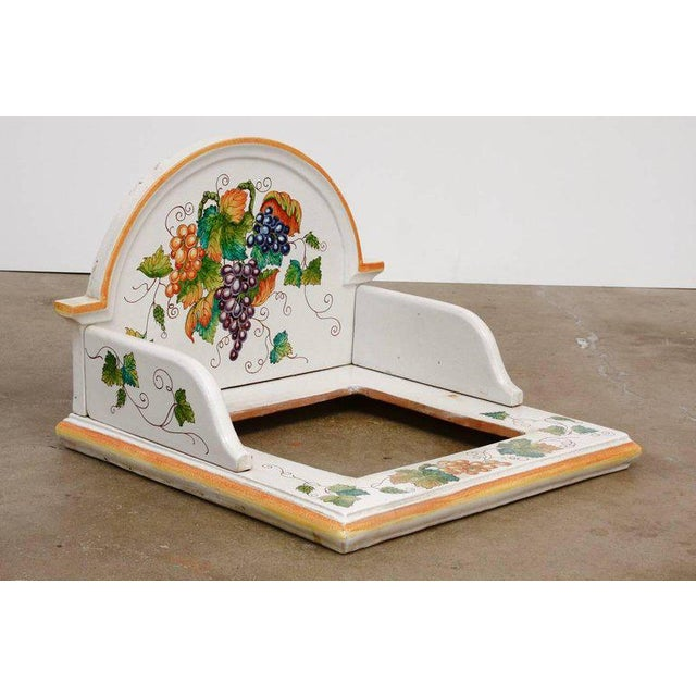 Unusual hand-painted Italian pottery ceramic hibachi or garden sink surround. Features an arched wash stand style backing...