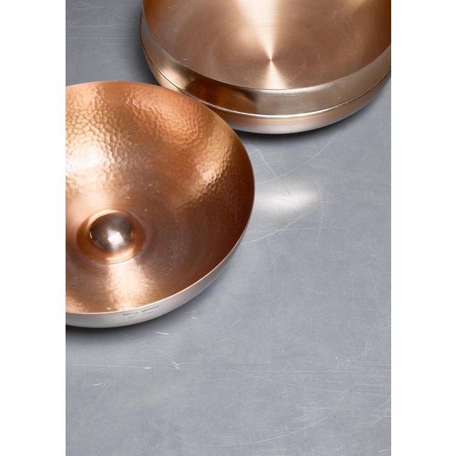 A pair of beautiful fruit bowls by Tapio Wirkkala for Kultakeskus Oy. The measurements stated are of the largest, brass,...
