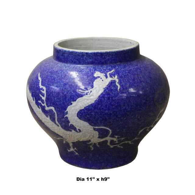 This is a handmade Chinese accent decorative vase jar made of ceramic. The surface is carved with relief dimensional...