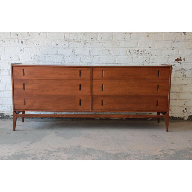 Mid-Century Modern solid walnut and rosewood dresser by Richard Thompson for Glenn of California. This fully restored...