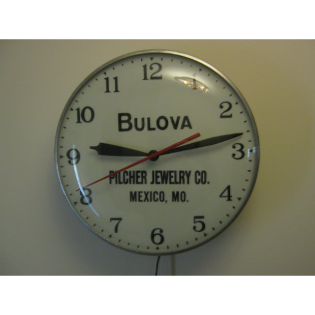 This working lighted clock came from the now closed Pilcher Jewelry Co. Mexico Missouri. It has an aluminum body with a...