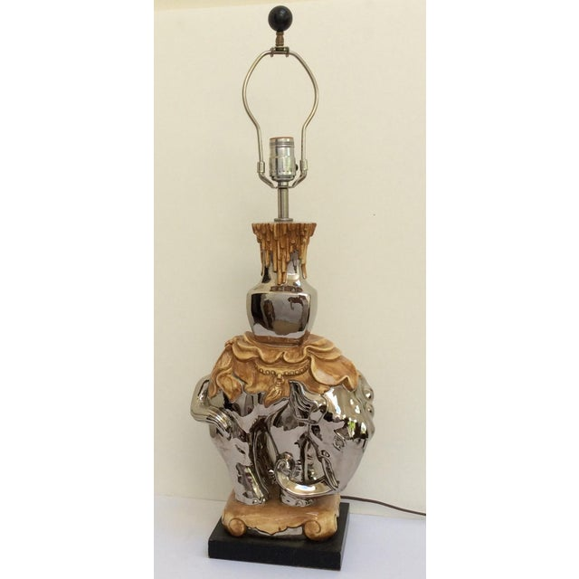 Mercury style finish ceramic elephant lamp.