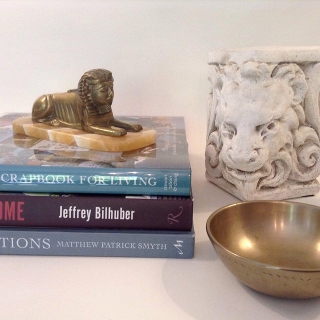 Vintage brass sphinx mounted on a marble platform. Heavyweight and perfect as an accent or paperweight.