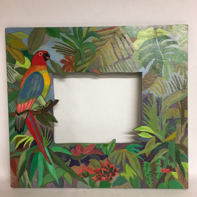 Wonderful mirror hand painted by Chicago artist, Nancy Weinberg. The colorful parrot lives in a green array of tropical...