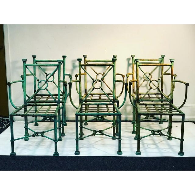 Interesting set of six Forged Highly Decorative Mixed Metal Chairs designed of Iron and Brass Ball Accents. Designed Circa...