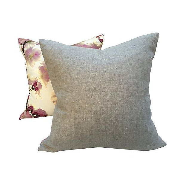 Pair of pillows with vintage dogwood floral textile on the fronts and new solid neutral linen backs. Hidden zipper...