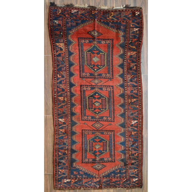 Offered is a very unique antique North Persian Kelardasht long rug featuring a triple medallion geometric pattern. Hand...