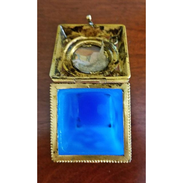Nice continental ring or pill box.......circa 1840......turquoise blue glass base.....gilt metal mounts......with lovely...