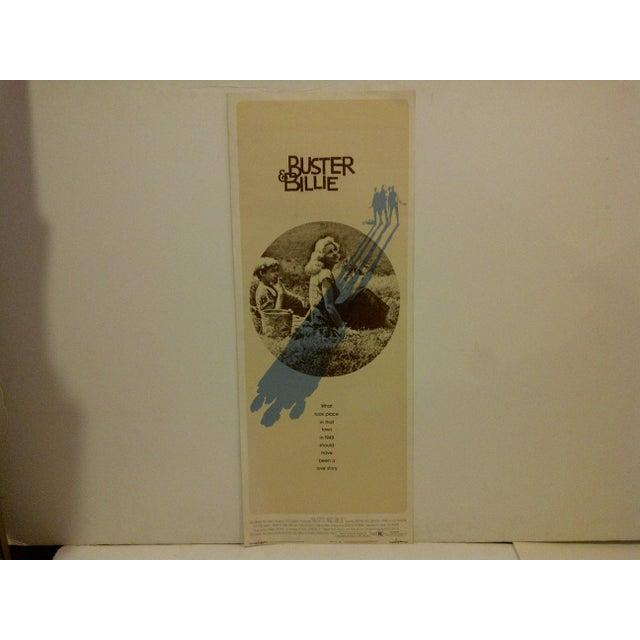 "A vintage movie poster ""Buster & Billie,"" starring Jan Michael Vincent and Pamela Sue Martin. 74/67 Copyright 1974,..."