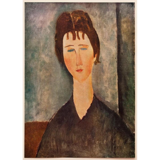 """A lovely tipped-in lithograph after painting """"Young Girl with Brown Hair"""" (1918) by Amedeo Modigliani. Comes from First..."""