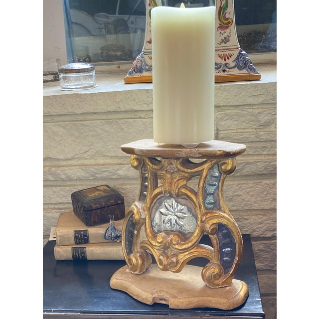 This 18th century stand is carved wood with gilt and has a glass center.