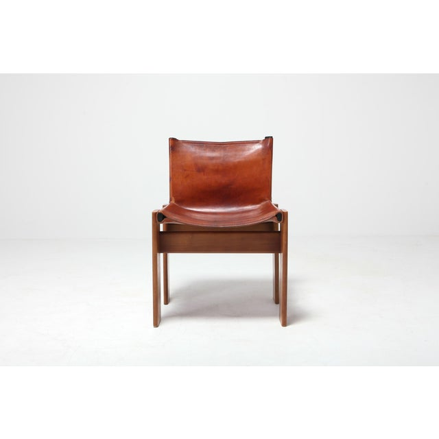 """Cognac leather """"Monk"""" chairs designed by Afra & Tobia Scarpa in 1974 and produced by Molteni. The frame is made of..."""