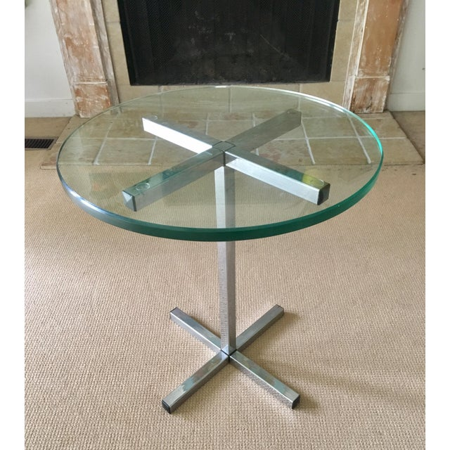 If you're a fan of Milo Baughman's sleek chrome designs, you'll love this 70's pedestal table. Built to last with half...