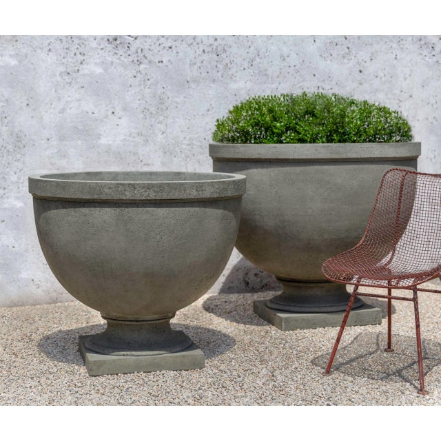 A simple planter set on a square base, in an Alpine Stone finish. Available in large and small versions.