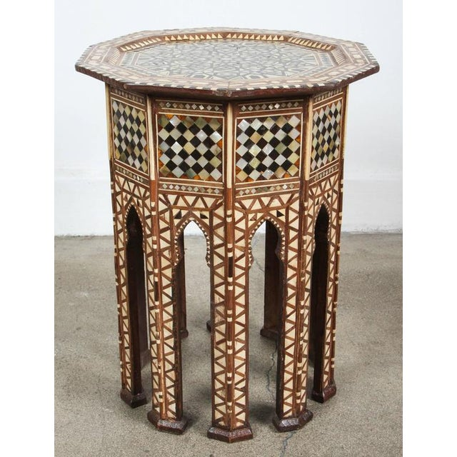 Pair of Syrian walnut octagonal side tables inlaid with mother-of-pearl, ebony, horn and camel bone. Handcrafted by...