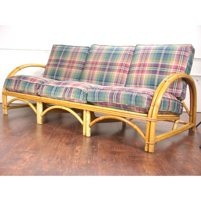Wonderful example of mid century craftsmanship. A beautiful and modern rattan and cane sofa purchased from a native of...