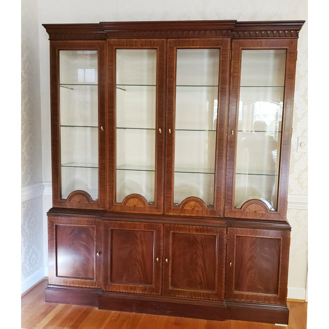 Near pristine Councill Craftsman mahogany breakfront with beveled glass that even curves around the fan shaped satinwood...