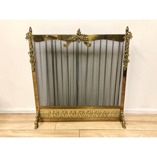 Beautiful vintage French Louis XVI-style fireplace screen in good working condition with knobs to top that easily slide...