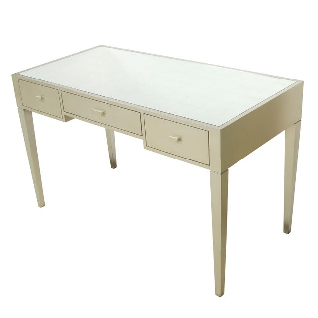 Vintage art deco silver leaf painted writing desk with three drawers and a reflective top
