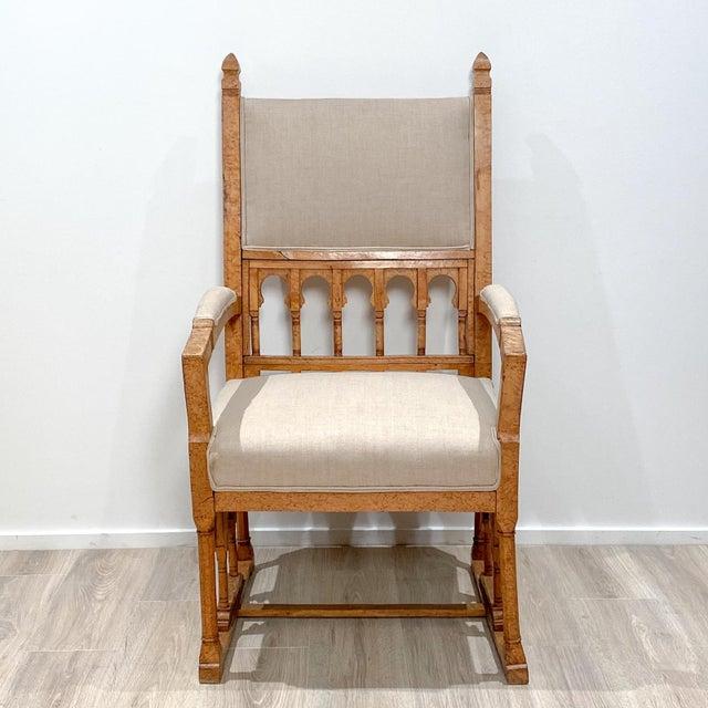A 19th century Russian Karelian birch Gothic armchair.