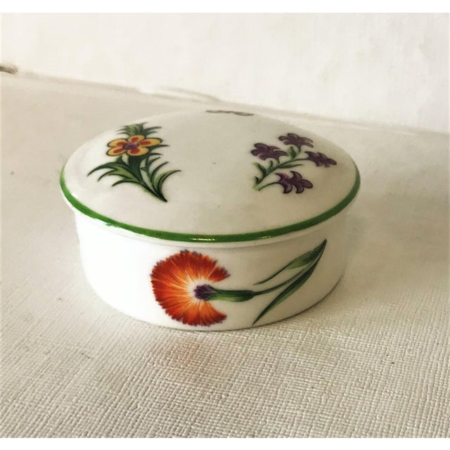 "Stunning Tiffany & Co. Limoges, France porcelain trinket box named ""Tiffany Garden."". This lovely round box has colorful..."