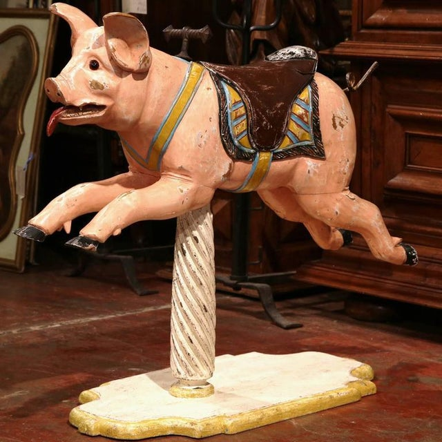 Incorporate old world charm into your home with this interesting antique, wooden carousel pig from France, circa 1890. The...